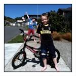 Elliot in front of his bike